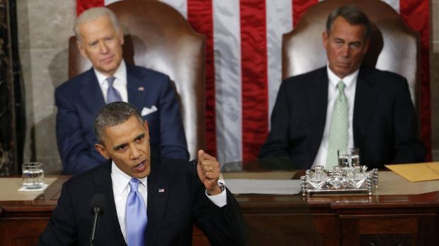 Barack Obama delivering his 2014 State of the Union address a year ago as Vice-President Joe Biden (left) and House ...