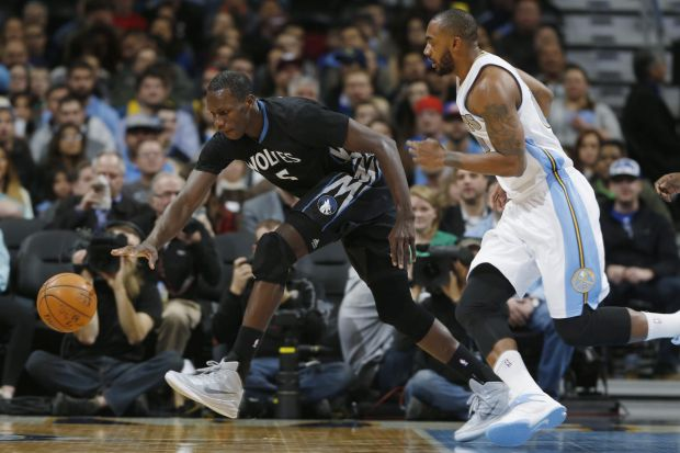 Loose ball: Minnesota Timberwolves centre Gorgui Dieng vies for possession with Nuggets forward Darrell Arthur in Denver.