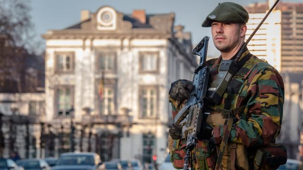 A Belgian commando patrols near the office of the Prime Minister in Brussels at the weekend.