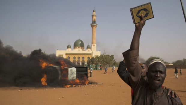 A man holds a copy of the Koran during a protest in Niamey at the weekend, after Niger's President Mahamadou Issoufou ...