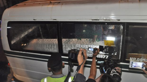 An ambulance carrying the body of convicted drug smuggler Namaona Denis, from Malawi, arrives at the port of Wijayapura ...