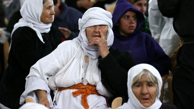 Yazidi women rest at the al-Tun Kopri health centre after their release from IS captivity.