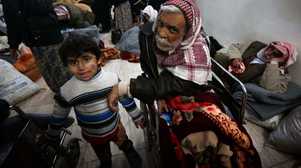 Yazidis wait for medical assistance after their release on Saturday.