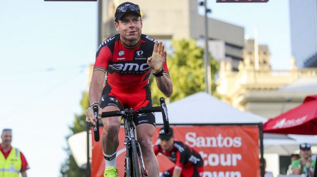 Cadel Evans waves to the crowd during the presentation of teams ahead of the 2015 Tour Down Under.