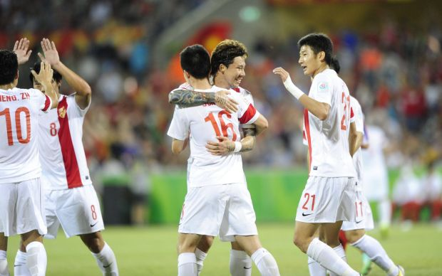 Centre,  China P.R. player Sun Ke celebrates his goal with team mates .