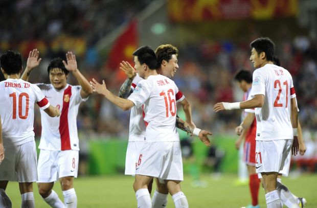 Centre,  China P.R. player Sun Ke celebrates his goal with team mates.