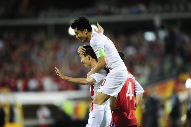 From left,  China P.R. player Sun Ke celebrates his goal with team mate.