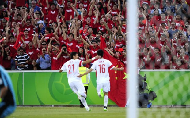 China celebrate their first goal.