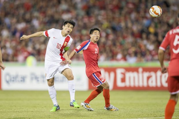 Zheng Zhi of The People's Republic of China with a head at goal.