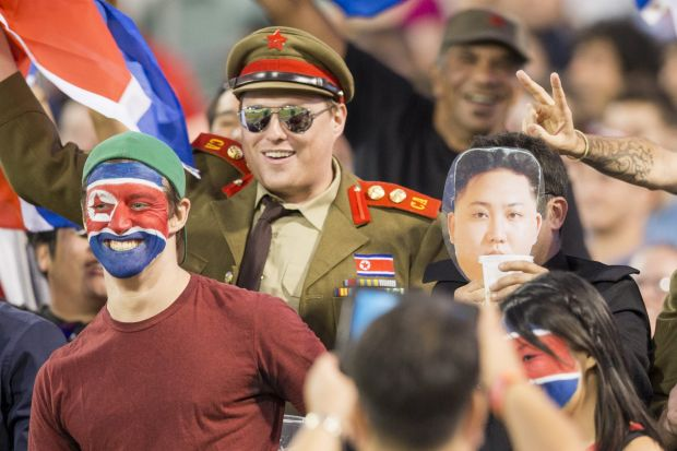 An impersonator of the Supreme Leader of North Korea Kim Jong-un draws a crowd as he arrives a the stadium.