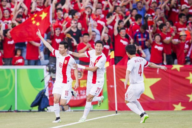 China draw first blood with a goal in the first few minutes of the game of the foot of Sun Ke of The People's Republic ...