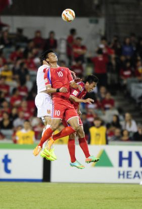 Left,  DPR Korea player Pak Kwang Ryong in action.