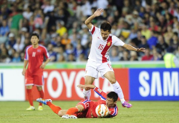 DPR Korea player So Hyon Uk and China P.R. player Wu Xi in action.