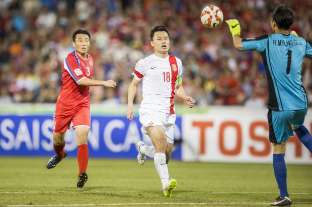 Gao Lin of The People's Republic of China attacking the Korean goal with Jang Song Hyok of The Democratic People's ...