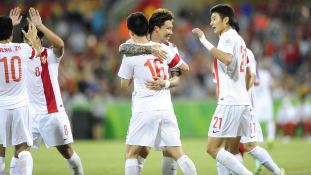 China's Sun Ke celebrates his goal with teammates.