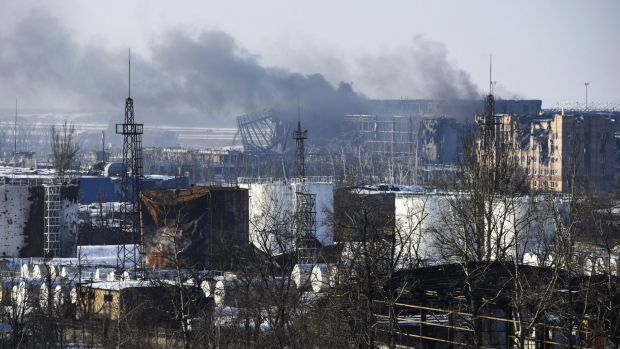 Smoke rises over the new terminal of Donetsk airport in eastern Ukraine.