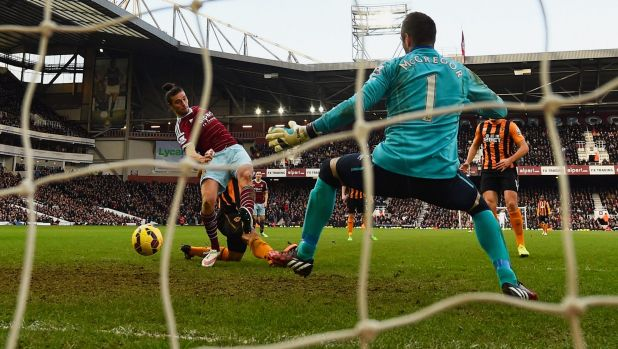 West Ham's Andy Carroll shoots past Hull goalkeeper Allan McGregor at Upton Park on Sunday.