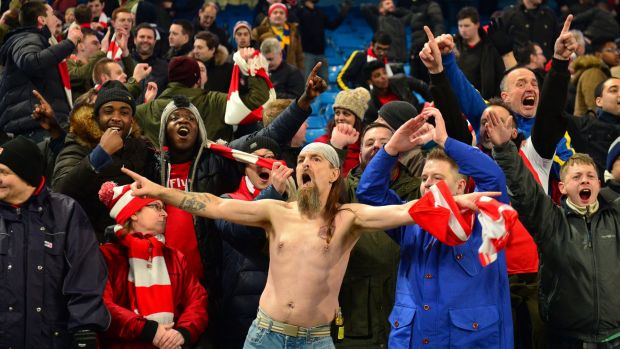 Arsenal fans celebrate their away win over title favourites Manchester City on Sunday.