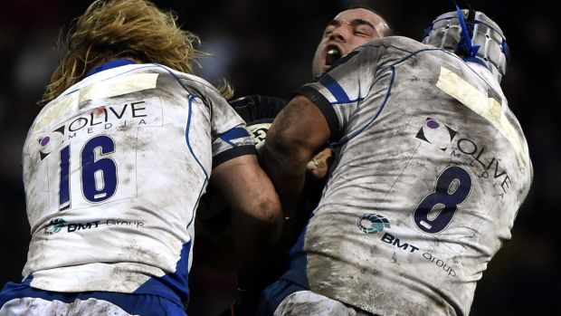Crunched: Toulouse scrum-half Jean-Marc Doussain is hit by Bath's hooker Ross Batty (L) and flanker Leroy Houston.