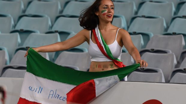 """Marriage proposal: """"Will Alireza marry me"""" is written on to the Iranian flag by a supporter during Iran's match against ..."""