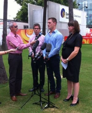 Brent Tate talking Work Cover outside Suncorp Stadium.