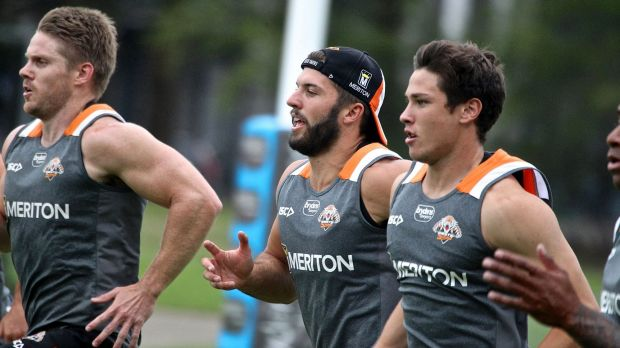 Gearing up for the season ahead: James Tedesco, centre, goes through his paces at Wests Tigers training at Concord on Monday.
