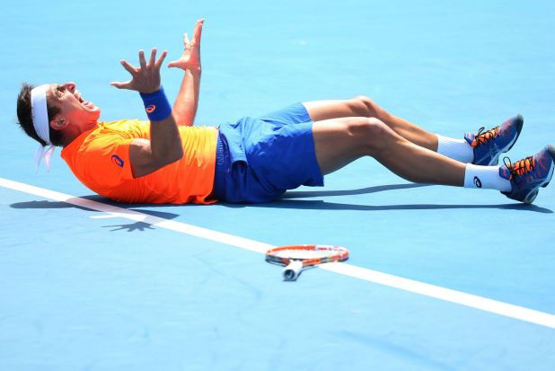 Breakthrough: Marinko Matosevic of Australia celebrates winning his first ever match at the Australian Open after ...
