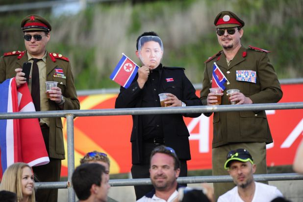 Spotted in the crowd: Spectators dress up in North Korean military garb at the Asian Cup match against China at Canberra ...