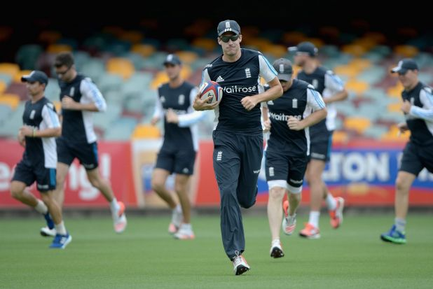 All-rounder: English paceman Steven Finn touches up on his rugby skills at the Gabba.