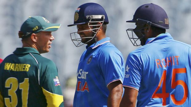 David Warner argues with Suresh Raina and Rohit Sharma during the one-day international at the MCG on Sunday.