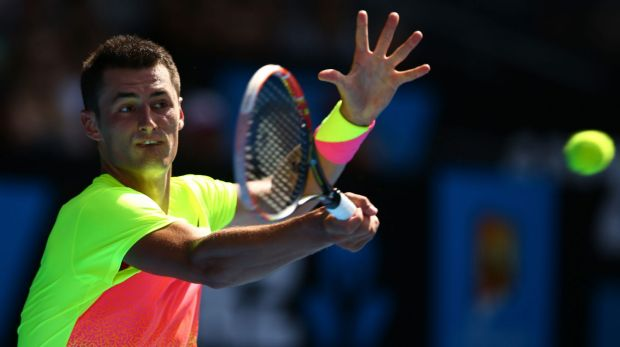 Bernard Tomic plays a forehand during his win on Monday.