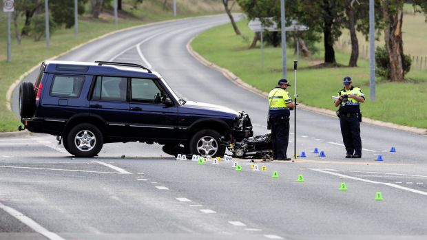 ACT police officers at the scene of the accident in Theodore.