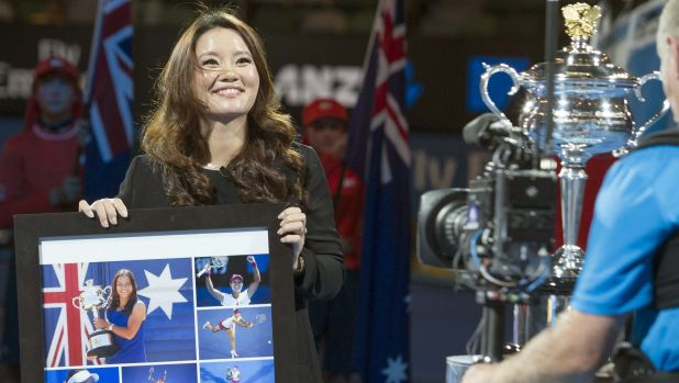 Family time: Australian Open champion Li Na holds a gift she was presented with during an official ceremony on Rod Laver ...