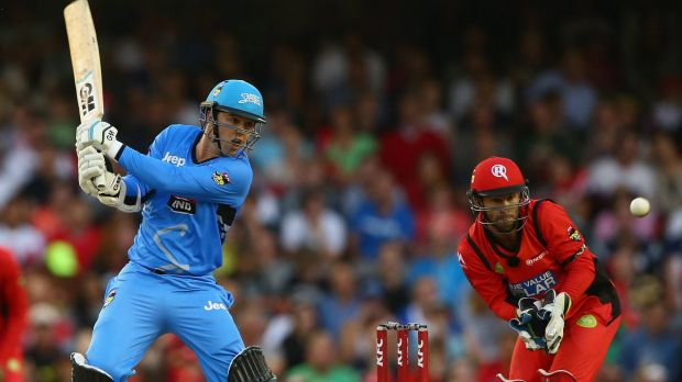 Travis Head of the Strikers cuts a delivery to the boundary during his knock of 71.