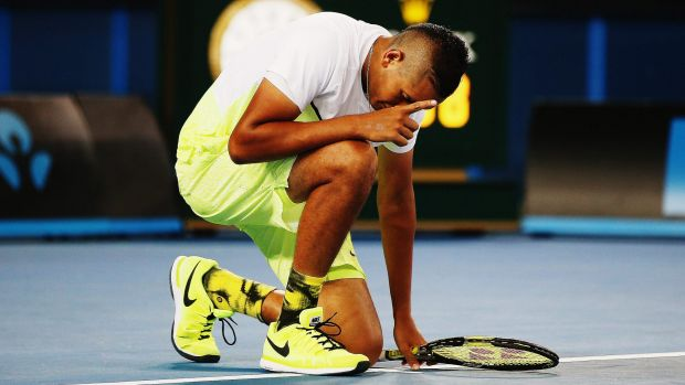 Nick Kyrgios goes down on knee after defeating Federico Delbonis of Argentina.