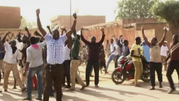 Protesters chant and raise their arms in Niamey, Niger, following the publication of Charlie Hebdo.