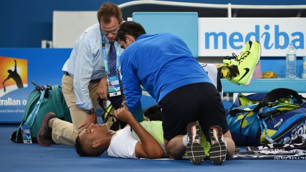 Nick Kyrgios receives treatment for his back during his first-round match.