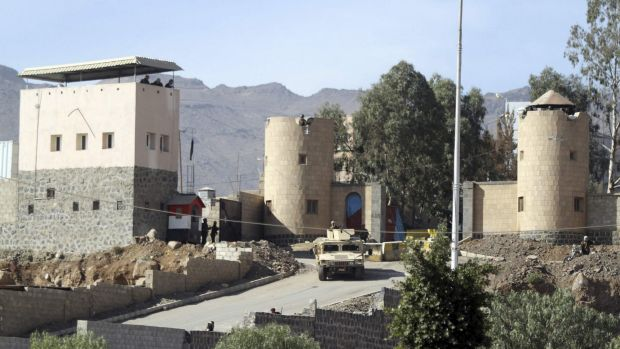 Under attack ... A vehicle from the Presidential Protection Forces is seen positioned outside the house of President Hadi