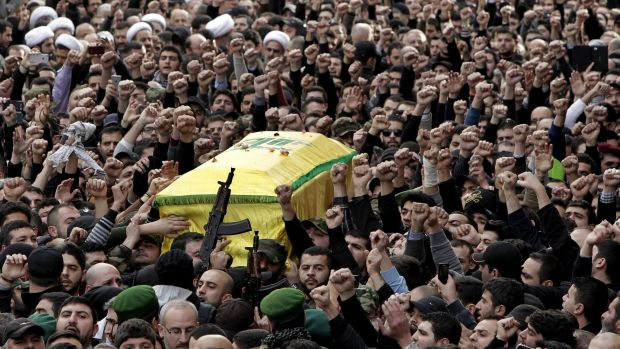 Hezbollah fighters in Beirut carry the coffin of Jihad Mughniyeh, the son of Imad Mughniyeh, a top Hezbollah operative ...