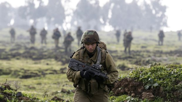 An Israeli soldier from the Golani brigade takes part in training near the city of Katzrin in the Israeli-occupied Golan ...