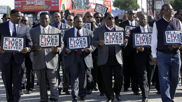 Birthday message: Members of the group Suits in Solidarity march at the annual Kingdom Day Parade in Los Angeles, in ...