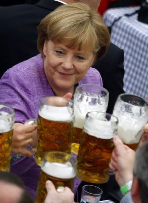 Handling it: Angela Merkel raises a glass at a traditional folk festival in southern Germany in 2012.