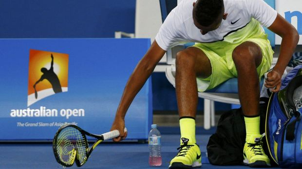 Smash it up: Nick Kyrgios breaks a racquet on Monday night.