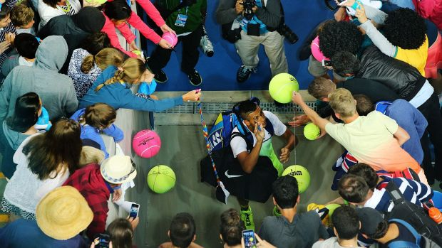 Nick Kyrgios is mobbed after his win at the Australian Open.
