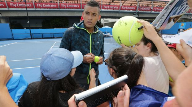 Nick Kyrgios signs autographs for fans during a practice session on Tuesday.