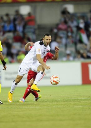 From left, Iraq player Justin Hikmat Azeez in action.