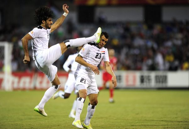 From left, Iraq players Ahmed Ibrahim clashes with his team mate Waleed Salim Al-Lami.