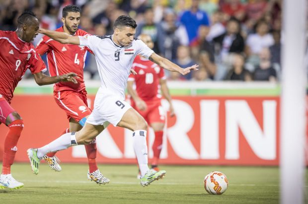 Ahmed Yaseen Gheni of Iraq attacking the goal.