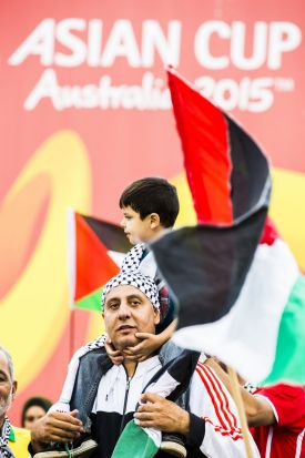 Palestinian fans get into the spirit of the match.
