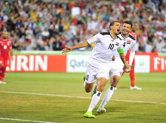 Iraq player Younus Mahmood scores the first goal for Iraq.